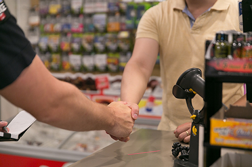 Image of Officer and Store Clerk shaking hands