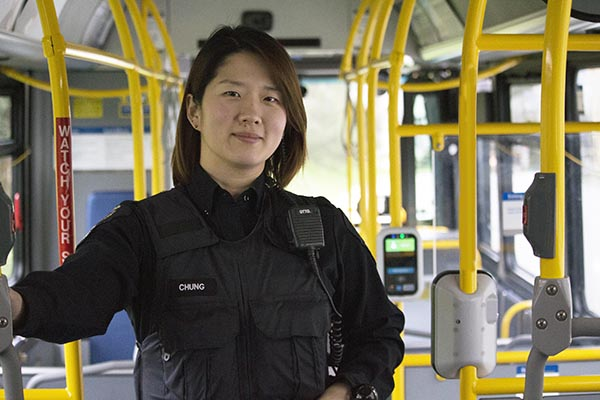 Image of Officer Jenny Chung On a Bus