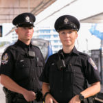 Two Officers standing on the SkyTrain Platform