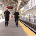 Two Officers Walking on the SkyTrain Platform