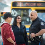 Transit Police Officer Engaging with Passengers